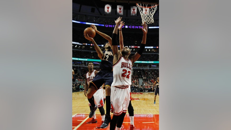 Indiana Pacers forward Chris Copeland (22) battles Chicago Bulls forward Taj Gibson (22) during the first half of an NBA basketball game on Saturday, Nov. 15, 2014, in Chicago. (AP Photo/Andrew A. Nelles)