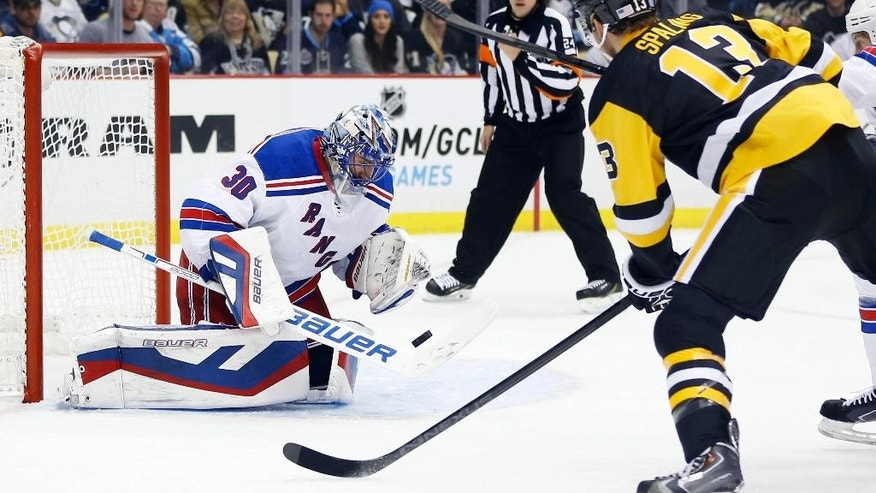 New York Rangers goalie Henrik Lundqvist (30) stops a shot by Pittsburgh Penguins' Nick Spaling (13) in the second period of an NHL hockey game, Saturday, Nov. 15, 2014, in Pittsburgh. (AP Photo/Keith Srakocic)