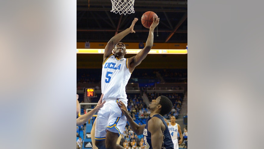 UCLA forward Kevon Looney shoots as Montana State forward Terrell Brown defends during the first half of an NCAA college basketball game, Friday, Nov. 14, 2014, in Los Angeles. (AP Photo/Mark J. Terrill)