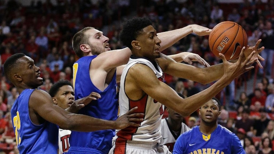 From left, Morehead guard Brent Arrington and center Billy Reader compete for a rebound with UNLV forward Christian Wood during the second half of an NCAA college basketball game Friday, Nov. 14, 2014, in Las Vegas. (AP Photo/John Locher)