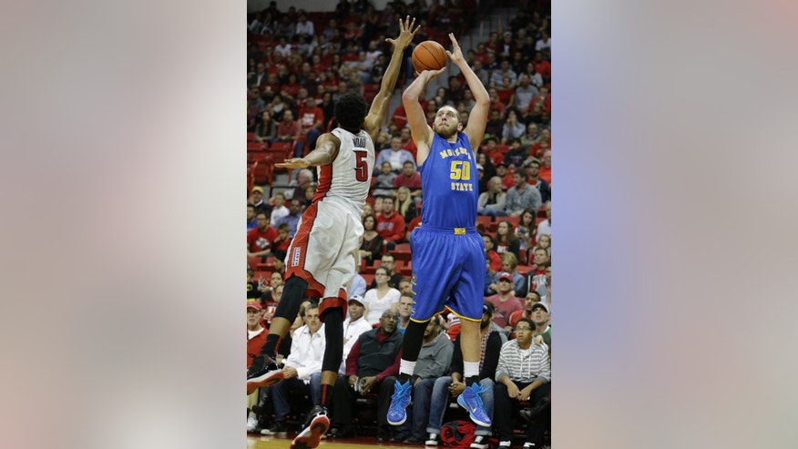 Morehead center Billy Reader, right, shoots against UNLV forward Christian Wood during the first half of an NCAA college basketball game Friday, Nov. 14, 2014, in Las Vegas. (AP Photo/John Locher)