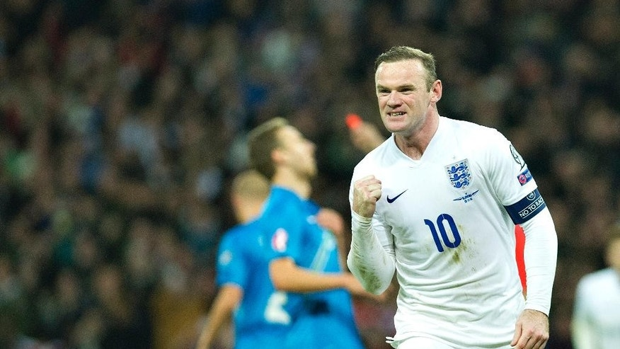 England's Wayne Rooney celebrates after scoring against Slovenia, during their Euro 2016 Group E qualifying soccer match at Wembley Stadium, London, Saturday, Nov. 15, 2014 (AP Photo/Bogdan Maran)