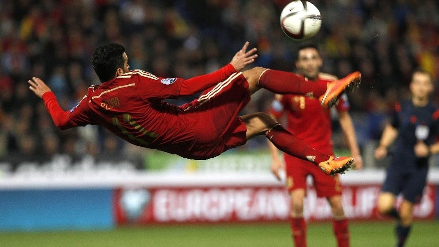 Spain's Pedro Rodriguez vies for the ball against Belarus during the Euro 2016 qualifying match between Spain and Belarus at the Nuevo Colombino stadium, in Huelva, Spain, Saturday Nov. 15, 2014. (AP Photo/Miguel Angel Morenatti)