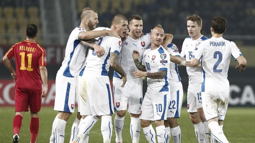 Slovakia's players celebrate after their teammate Juraj Kucka scored against Macedonia, during their Group C, Euro 2016 qualifying soccer match, at the Philip II stadium, in Skopje, Macedonia, Saturday, Nov. 15, 2014. (AP Photo/Boris Grdanoski)