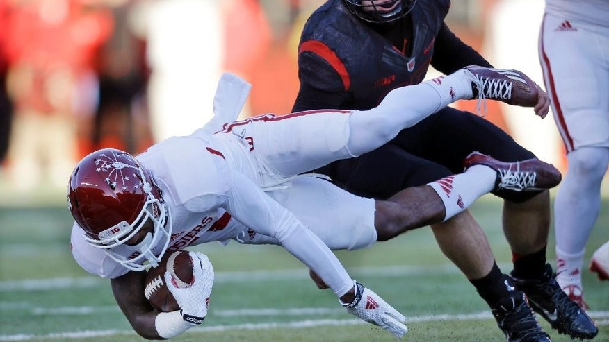 Indiana wider receiver Shane Wynn (1) dives for yardage as Rutgers long snapper Alan Lucy (85) makes a tackle  quarterback Zander Diamont (12) during the first half of an NCAA college football game Saturday, Nov.15, 2014, in Piscataway, N.J. (AP Photo/Mel Evans)