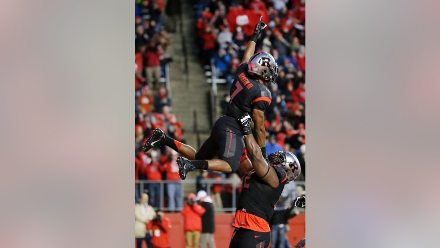 Rutgers running back Robert Martin (7) is hoisted in the air as he celebrates his touchdown during the first half of an NCAA college football game against Indiana Saturday, Nov.15, 2014, in Piscataway, N.J. (AP Photo/Mel Evans)