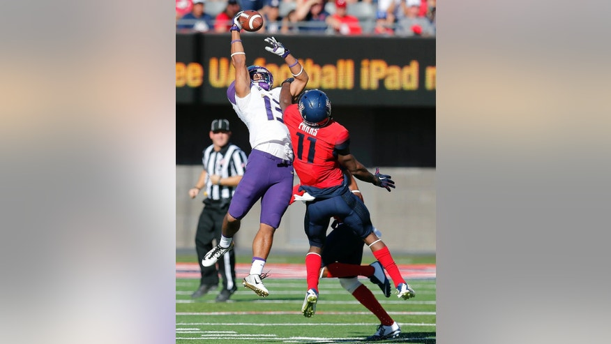 Washington wide receiver Kendyl Taylor (13) makes the catch in front of Arizona safety William Parks (11) during the first half of an NCAA college football game, Saturday, Nov. 15, 2014, in Tucson, Ariz. (AP Photo/Rick Scuteri)