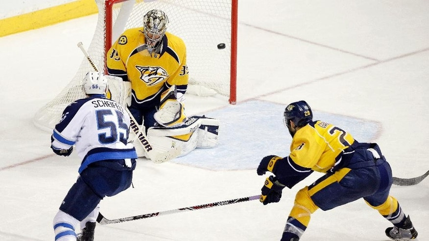 Nashville Predators goalie Pekka Rinne (35), of Finland, blocks a shot by Winnipeg Jets center Mark Scheifele (55) as Nashville Predators center Paul Gaustad (28) tries to block the shot in the third period of an NHL hockey game Saturday, Nov. 15, 2014, in Nashville, Tenn. The Predators won 2-1. (AP Photo/Mark Humphrey)