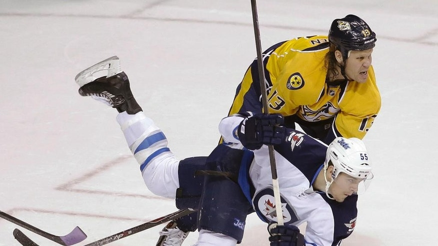 Winnipeg Jets center Mark Scheifele (55) trips over the stick of Nashville Predators center Olli Jokinen (13), of Finland, in the second period of an NHL hockey game Saturday, Nov. 15, 2014, in Nashville, Tenn. (AP Photo/Mark Humphrey)