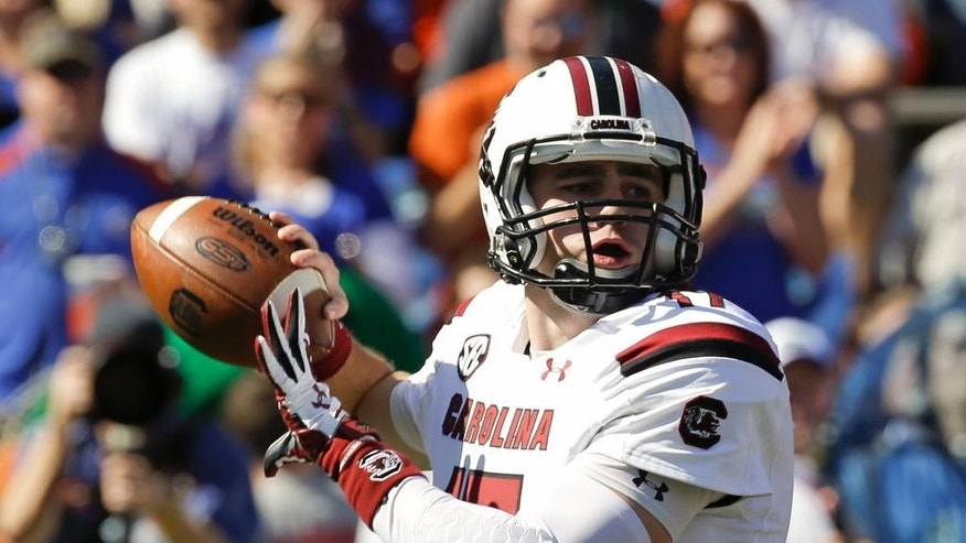 South Carolina quarterback Dylan Thompson throws a pass during the first half of an NCAA college football game against Florida in Gainesville, Fla., Saturday, Nov. 15, 2014. (AP Photo/John Raoux)