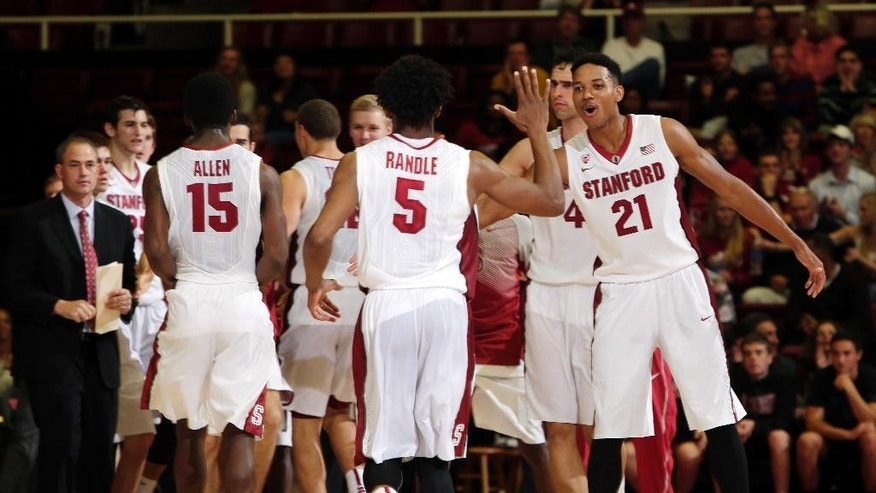 Stanford's Anthony Brown (21) celebrates with teammate Chasson Randle (5) after a Stanford score during the first half of an NCAA college basketball game against Wofford on Friday, Nov. 14, 2014, in Stanford, Calif. (AP Photo/Marcio Jose Sanchez)