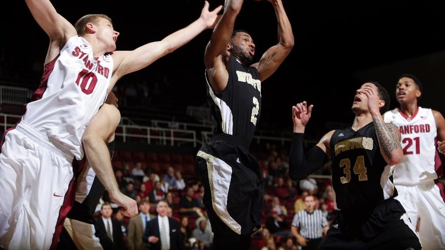 Wofford's Karl Cochran, center, grabs a rebound against Stanford during the first half of an NCAA college basketball game Friday, Nov. 14, 2014, in Stanford, Calif. (AP Photo/Marcio Jose Sanchez)