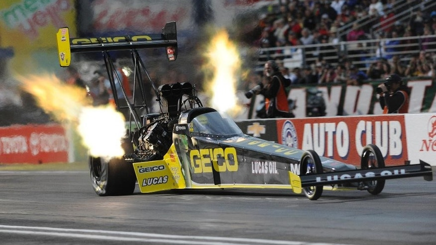 n this photo submitted by the NHRA, Richie Crampton races to his first career No. 1 in qualifying in Top Fuel, at the Auto Club NHRA Finals drag races Saturday, Nov. 15, 2014, in Pomona, Calif. (AP Photo/NHRA, Jerry Foss)