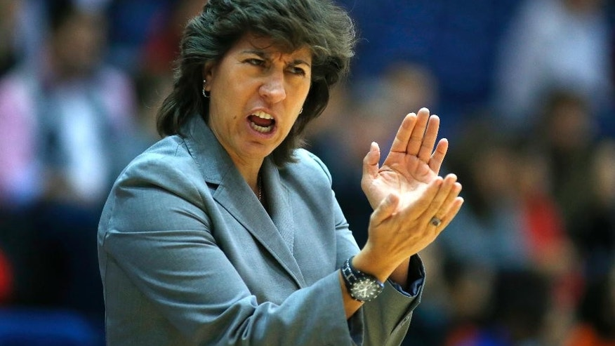 New Mexico Lobos head coach Yvonne Sanchez yells out instructions to her team during the second half of an NCAA women's college basketball game against the Texas A&M Aggies at McGrath-Phillips Arena in Chicago, on Saturday Nov. 15, 2014. The Aggies won 66-52. (AP Photo/Jeff Haynes)