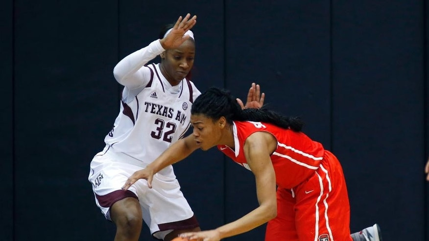 Texas A&M Aggies forward Tavarsha Scott-Williams (32) guards New Mexico Lobos forward Khadijah Shumpert (13) during the second half of an NCAA women's college basketball game at McGrath-Phillips Arena in Chicago, on Saturday Nov. 15, 2014. The Aggies won 66-52. (AP Photo/Jeff Haynes)