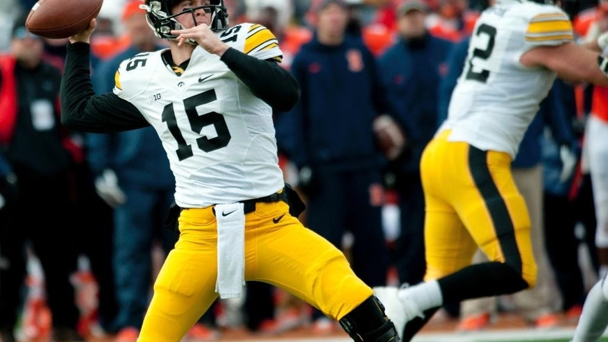 Iowa quarterback Jake Rudock (15) throws the ball during the second quarter of an NCAA football game against Illinois Saturday, Nov. 15, 2014, at Memorial Stadium in Champaign, Ill. (AP Photo/Bradley Leeb)