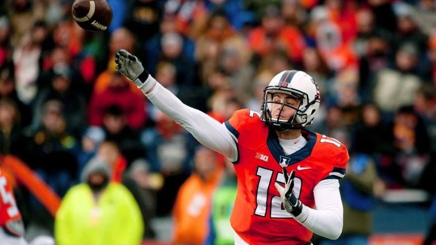 Illinois quarterback Wes Lunt (12) throws the ball during the second quarter against Iowa in an NCAA football game Saturday, Nov. 15, 2014, at Memorial Stadium in Champaign, Ill. (AP Photo/Bradley Leeb)