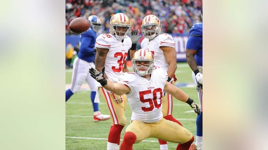 San Francisco 49ers inside linebacker Chris Borland (50) celebrates after intercepting a pass during the first half of an NFL football game against the New York Giants, Sunday, Nov. 16, 2014, in East Rutherford, N.J. (AP Photo/Bill Kostroun)