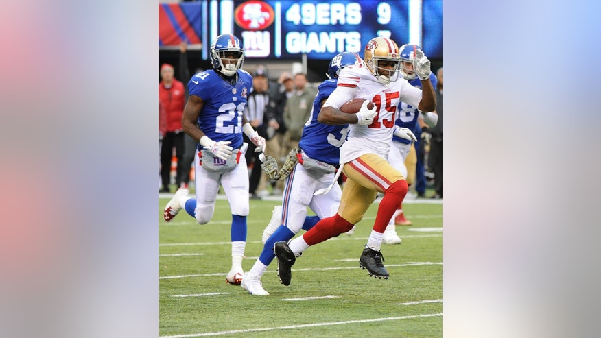 San Francisco 49ers wide receiver Michael Crabtree (15) runs away New York Giants' Dominique Rodgers-Cromartie (21) for a touchdown during the second half of an NFL football game Sunday, Nov. 16, 2014, in East Rutherford, N.J.  (AP Photo/Bill Kostroun)