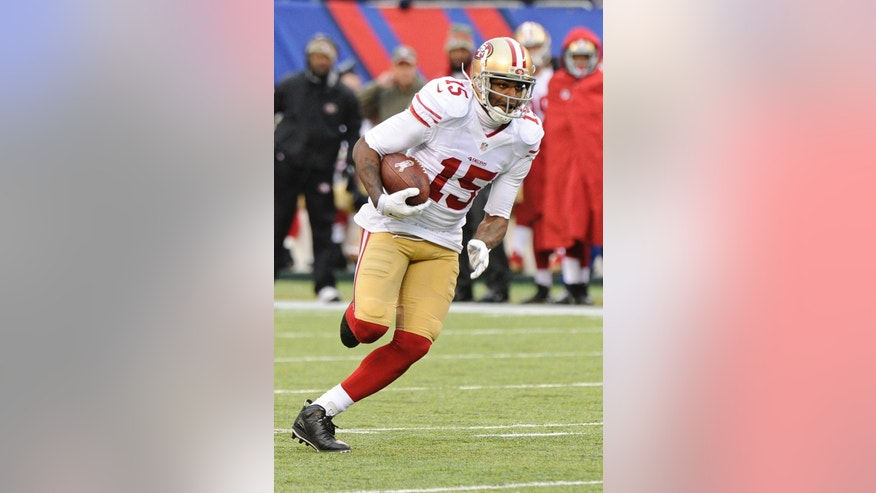 San Francisco 49ers wide receiver Michael Crabtree runs for a touchdown during the second half of an NFL football game against the New York Giants, Sunday, Nov. 16, 2014, in East Rutherford, N.J.  (AP Photo/Bill Kostroun)