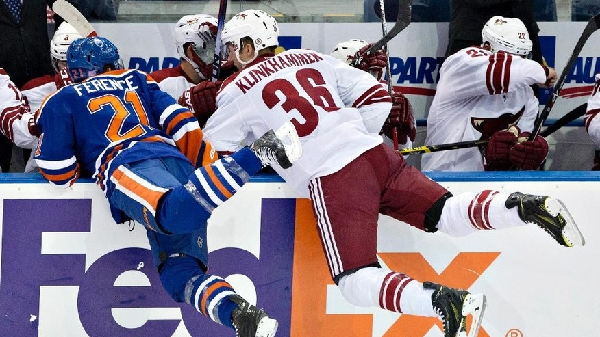 Arizona Coyotes Rob Klinkhammer (36) and Edmonton Oilers Andrew Ference (21) collide during first period NHL hockey action in Edmonton, Alberta, on Sunday,  Nov. 16, 2014. (AP Photo/The Canadian Press, Jason Franson)
