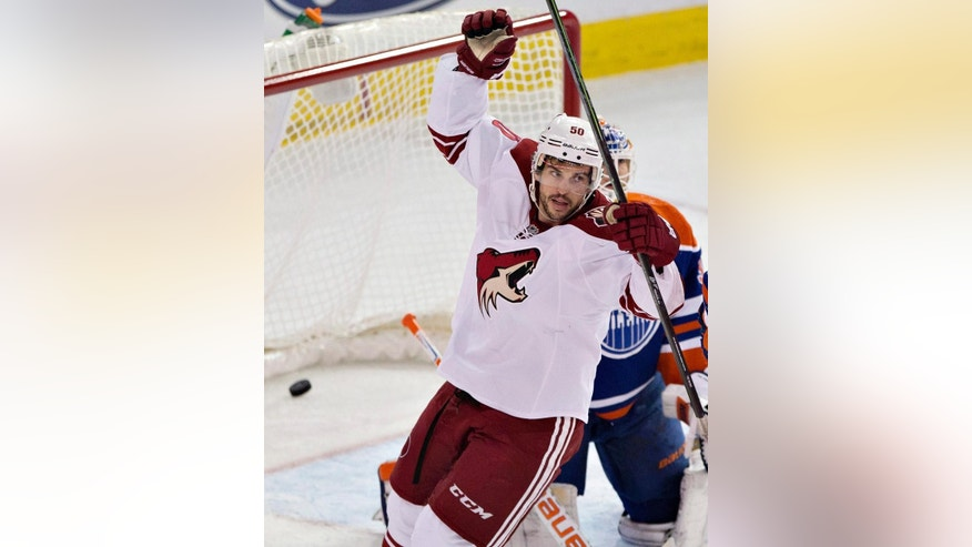 Arizona Coyotes Antoine Vermette (50) celebrates a goal by a teammate against Edmonton Oilers goalie Ben Scrivens (30) during first period NHL hockey action in Edmonton, Alberta, on Sunday,  Nov. 16, 2014. (AP Photo/The Canadian Press, Jason Franson)