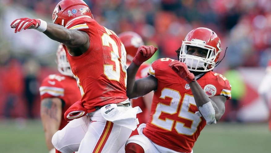 Kansas City Chiefs running back Jamaal Charles (25) celebrates a touchdown scored by running back Knile Davis (34) in the second half of an NFL football game against the Seattle Seahawks in Kansas City, Mo., Sunday, Nov. 16, 2014. (AP Photo/Charlie Neibergall)