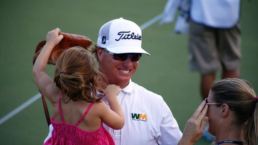 Charley Hoffman celebrates with his family after winning the OHL Classic at Mayacoba golf tournament in Playa del Carmen, Mexico, Sunday, Nov. 16, 2014. Hoffman rallied from a three-shot deficit Sunday by closing with a 5-under 66 for a one-shot victory over Shawn Stefani. (AP Photo/Israel Leal)
