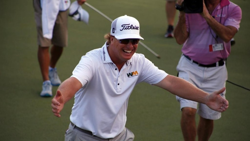 Charley Hoffman runs towards his family after winning the OHL Classic at Mayacoba golf tournament in Playa del Carmen, Mexico, Sunday, Nov. 16, 2014. Hoffman rallied from a three-shot deficit Sunday by closing with a 5-under 66 for a one-shot victory over Shawn Stefani. (AP Photo/Israel Leal)