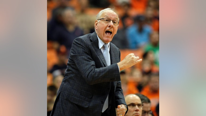 Syracuse head coach Jim Boeheim yells to his players in the first half of an NCAA college basketball game against Hampton in Syracuse, N.Y., Sunday, Nov. 16, 2014. (AP Photo/Nick Lisi)
