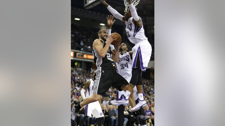 San Antonio Spurs guard Manu Ginobili, of Agrentina, left, is doubled teamed by   Sacramento Kings Jason Thompson, center and Ben McLemore,  during the first quarter of an NBA basketball game in Sacramento, Calif., Saturday, Nov. 15, 2014.(AP Photo/Rich Pedroncelli)