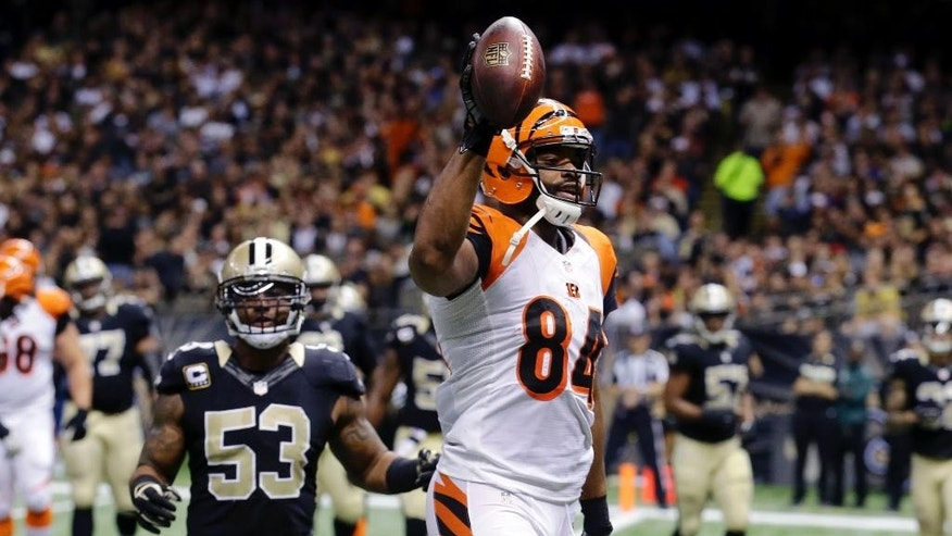 Cincinnati Bengals tight end Jermaine Gresham (84) crosses into the end zone on a touchdown reception as New Orleans Saints inside linebacker Ramon Humber (53) pursues in the second half of an NFL football game in New Orleans, Sunday, Nov. 16, 2014. (AP Photo/Bill Haber)