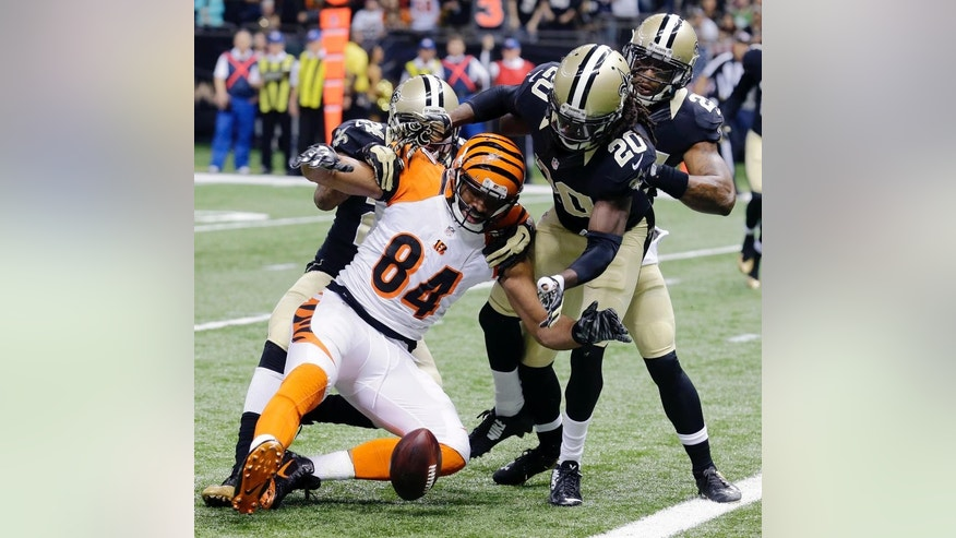 Cincinnati Bengals tight end Jermaine Gresham (84) fumbles into the end zone in front of New Orleans Saints defensive back A.J. Davis (20) in the first half of an NFL football game in New Orleans, Sunday, Nov. 16, 2014. (AP Photo/Bill Haber)