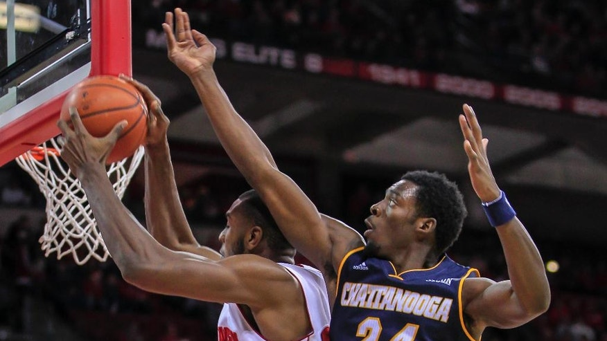 Wisconsin's Vitto Brown, left, pulls a defensive rebound away from Chattanooga's Casey Jones during the first half of an NCAA college basketball game Sunday, Nov. 16, 2014, in Madison, Wis. (AP Photo/Andy Manis)
