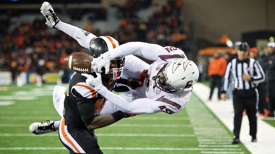 Oregon State cornerback Larry Scott breaks up a pass intended for Arizona State receiver Cameron Smith (6) during the second quarter of an NCAA college football game in Corvallis, Ore., Saturday, Nov. 15, 2014. (AP Photo/Troy Wayrynen)