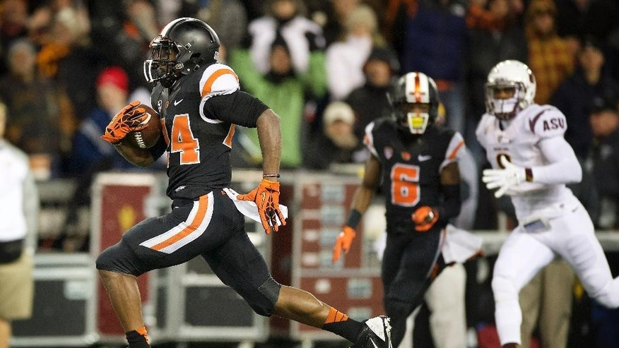 Oregon State tailback Storm Woods (24) scores a touchdown against Arizona State during the first quarter of an NCAA college football game in Corvallis, Ore., Saturday, Nov. 15, 2014. (AP Photo/Troy Wayrynen)