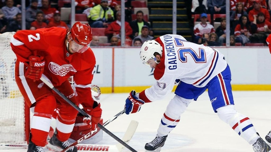 Montreal Canadiens center Alex Galchenyuk (27) tries to shoot as Detroit Red Wings defenseman Brendan Smith (2) defends in the second period of an NHL hockey game in Detroit Sunday, Nov. 16, 2014. (AP Photo/Paul Sancya)