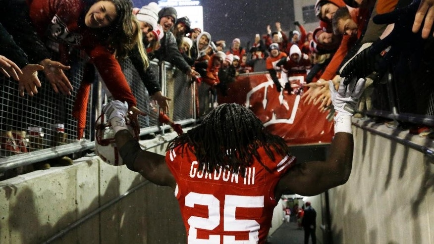 Wisconsin's Melvin Gordon celebrates with fans after their 59-24 win over Nebraska in an NCAA college football game Saturday, Nov. 15, 2014, in Madison, Wis. Gordon rushed for a major college-record 408 yards and four touchdowns in the game. (AP Photo/Morry Gash)
