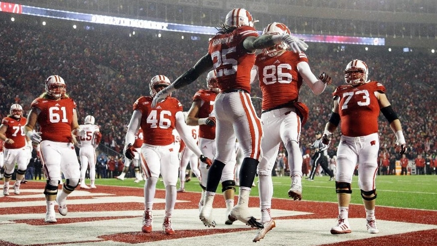 Wisconsin's Melvin Gordon celebrates a 1-yard touchdown run in the third quarter of an NCAA college football game against Nebraska Saturday, Nov. 15, 2014, in Madison, Wis. (AP Photo/Morry Gash)