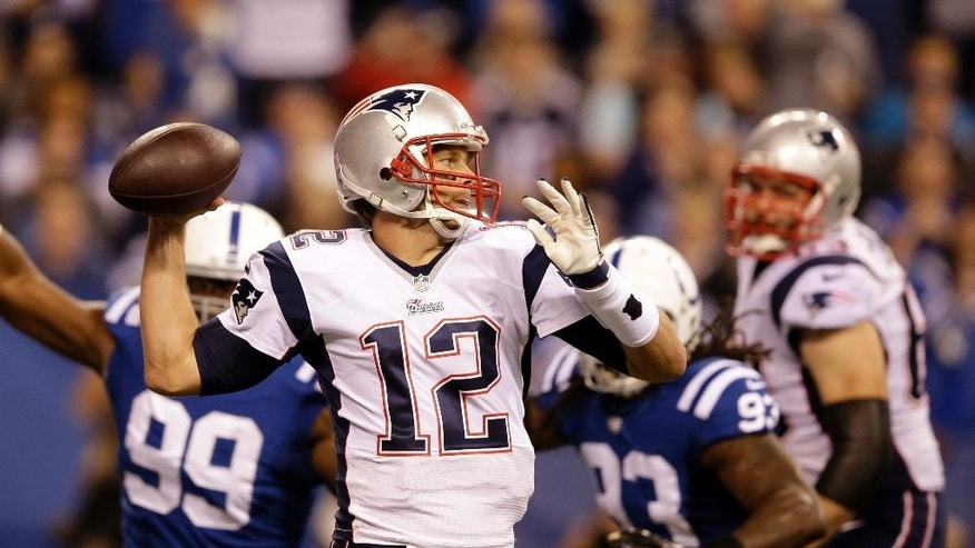 New England Patriots quarterback Tom Brady throws against the Indianapolis Colts during the first half of an NFL football game in Indianapolis, Sunday, Nov. 16, 2014. (AP Photo/Darron Cummings)