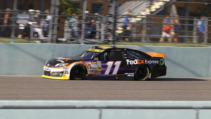 Denny Hamlin drives in the NASCAR Sprint Cup championship series auto race, Sunday, Nov. 16, 2014, in Homestead, Fla. (AP Photo/Terry Renna)