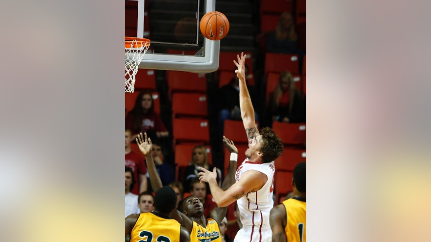 Oklahoma forward Ryan Spangler, second from right, goes up for a basket in front of Southeastern Louisiana players during the first half of an NCAA college basketball game in Norman, Okla., Sunday, Nov. 16, 2014. (AP Photo/ Alonzo Adams)