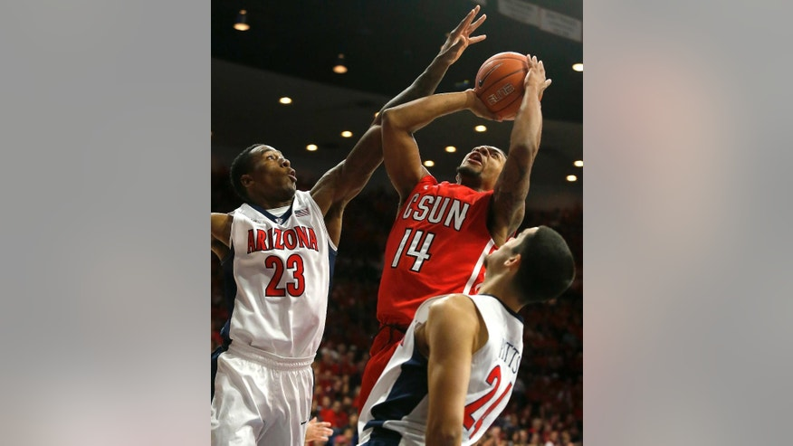 Cal State Northridge guard Aaron Parks (14) shoots over Arizona forward Rondae Hollis-Jefferson (23) and Elliott Pitts (24) during the first half of an NCAA college basketball game, Sunday, Nov. 16, 2014, in Tucson, Ariz. (AP Photo/Rick Scuteri)