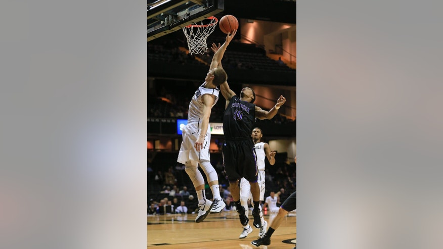 Vanderbilt guard Riley LaChance, left, and Trevecca Nazarene's Byron Sanford (10) reach for a rebound in the first half of an NCAA college basketball game Sunday, Nov. 16, 2014, in Nashville, Tenn. (AP Photo/Mark Humphrey)