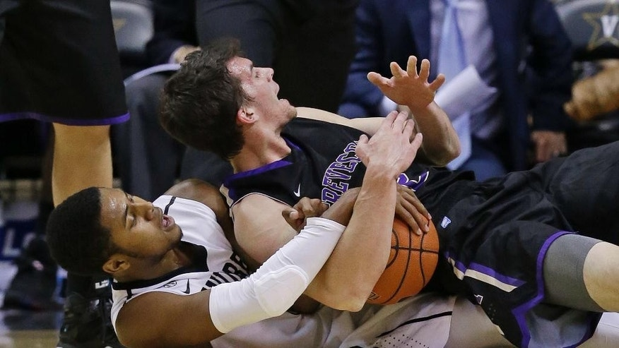 Trevecca Nazarene's Christopher Elliott, top, tries to call a timeout as he and Vanderbilt guard Shelton Mitchell wrestle for the ball in the first half of an NCAA college basketball game Sunday, Nov. 16, 2014, in Nashville, Tenn. (AP Photo/Mark Humphrey)