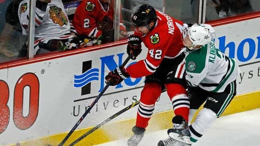 Chicago Blackhawks center Joakim Nordstrom and Dallas Stars defenseman John Klingberg (3) collide during the third period of an NHL hockey game on Sunday, Nov. 16, 2014, in Chicago. The Chicago Blackhawks won 6-2. (AP Photo/Andrew A. Nelles)