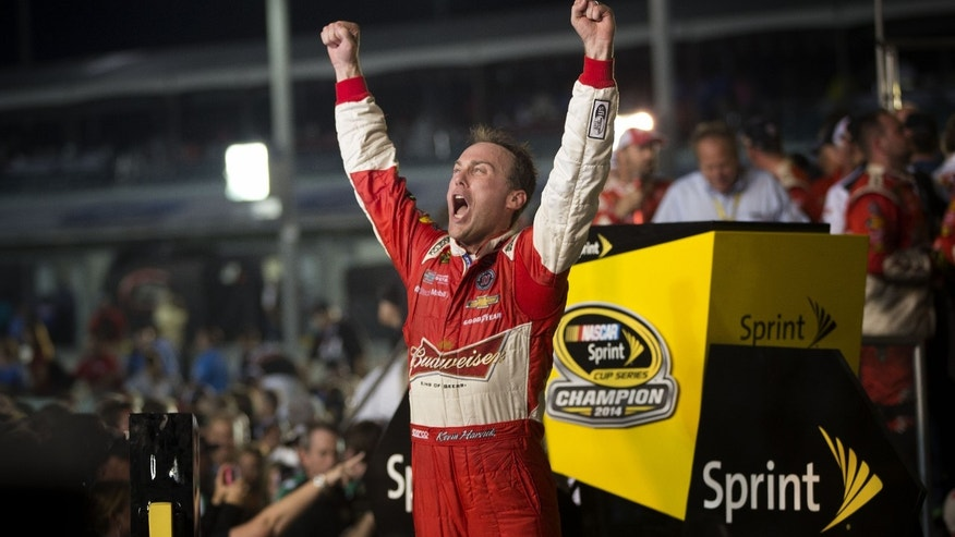 Nov. 16, 2014: Kevin Harvick celebrates after winning the NASCAR Sprint Cup championship series auto race.