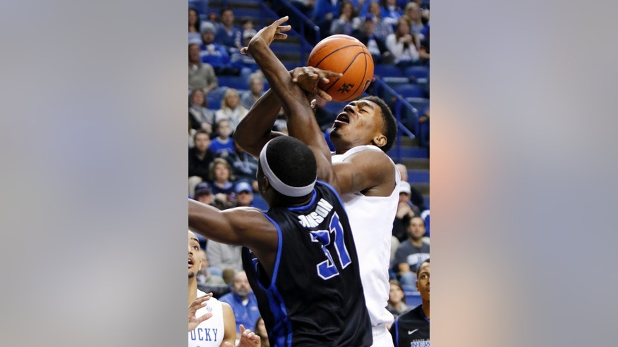 Kentucky's Dakari Johnson, right, has his shot blocked by Buffalo's Raheem Johnson during the first half of an NCAA college basketball game, Sunday, Nov. 16, 2014, in Lexington, Ky.  (AP Photo/James Crisp)