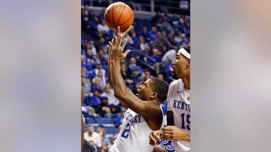 Kentucky's Aaron Harrison, left, shoots near teammate Willie Cauley-Stein during the first half of an NCAA college basketball game against Buffalo, Sunday, Nov. 16, 2014, in Lexington, Ky.  (AP Photo/James Crisp)