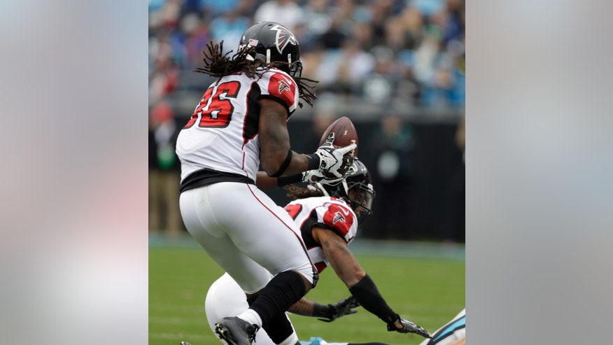 Atlanta Falcons' Kemal Ishmael (36) intercepts a Carolina Panthers pass in the first half of an NFL football game in Charlotte, N.C., Sunday, Nov. 16, 2014. (AP Photo/Bob Leverone)